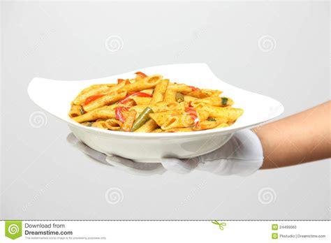 hand holding  bowl  pasta stock photo image