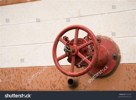 fire department valve a red fire department shut off valve on a building stock