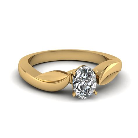leaf oval shaped solitaire engagement ring in 14k yellow