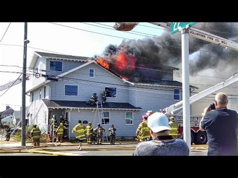 anaheim firefighter falls through roof house in lbi doovi