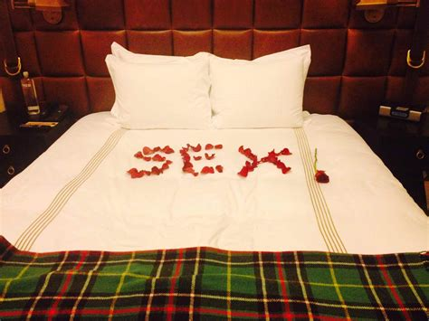 rose petals on bed guy has hotel staff write romantic message in rose petals on their bed for valentine s