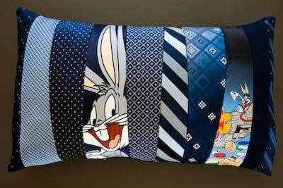 a pillow made from ties the idea of with