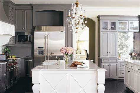 dark grey island with white countertop and antique white dark gray kitchen cabinets with white island
