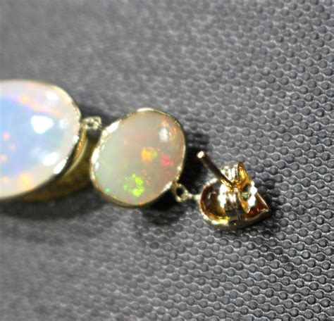1550 Ct Jumbo Size Yellow Opal handmade yellow sapphire and 19 ct opal earrings in from cham nyc on
