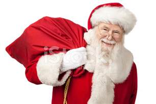 pictures of real santa claus carrying a gift bag stock