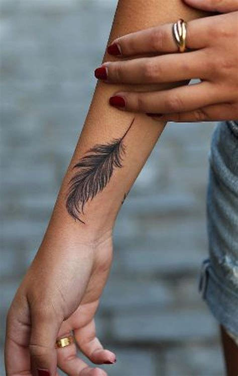 tattoos for women on wrist and hand 20 feather ideas for mini
