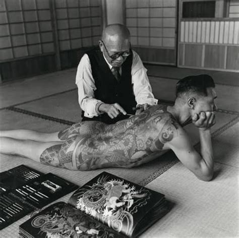 hand tattoo gang an irezumi artist tattoos a yakuza member with the