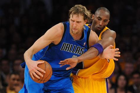 kobe bryant bench press dirk nowitzki hits game winner kobe bryant gives pat of approval from bench for the win