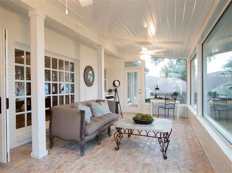 Sunroom At The Brick rustic brick floor and cozy gray sofa in country sunroom hgtv
