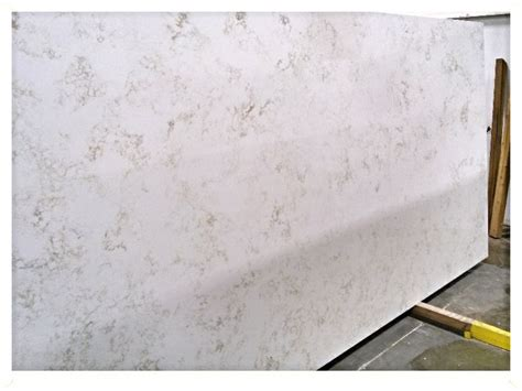 calcutta gold quartz pin by fiorano tile showrooms on quartz countertops