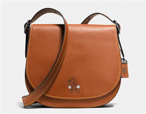 Ready Tas Coach Mickey Croosbody coach debuts new collection with disney featuring mickey mouse bags accessories and more
