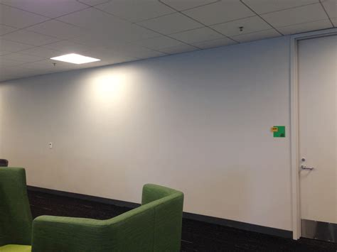 office wall decor worker uses 8 024 post it notes to turn boring office