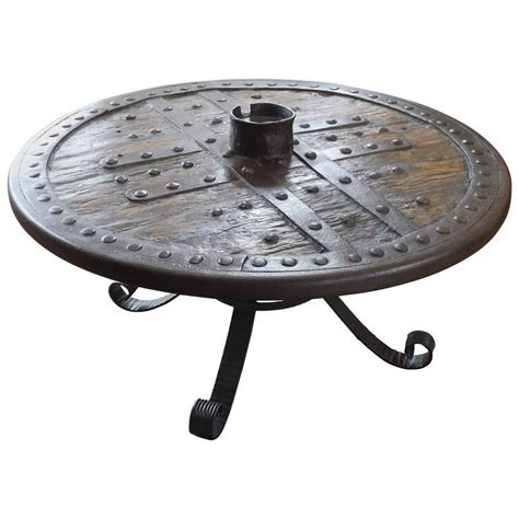 Wagon Wheel Coffee Table Forged Iron And Hardwood Wagon Or Chariot Wheel Coffee Table At 1stdibs