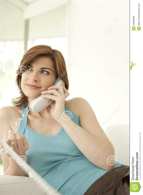 speaking on phone at home royalty free stock images