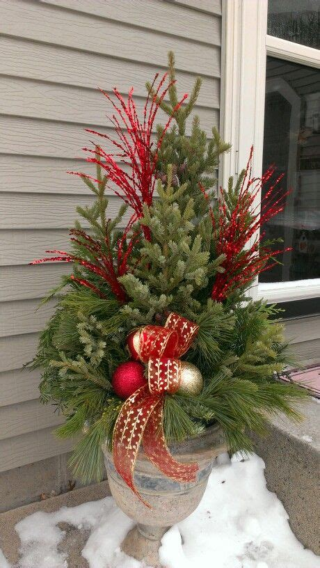 christmas decorating huge stone urns in front of entrance 3042 best images about garden containers on container plants fall containers and