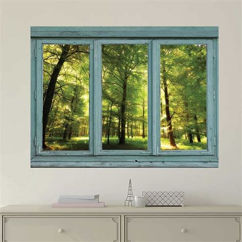 Beach Wall Murals window looking out into a green forest and sun rays wall