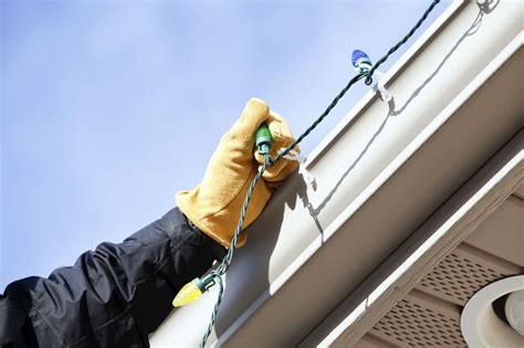 how to hang christmas lights under eaves tips for hanging lights on a variety of surfaces