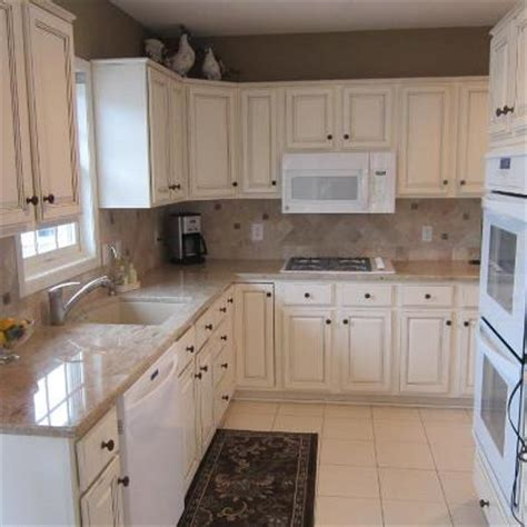 refinish kitchen cabinets white oak cabinets to white enamel with glaze painterati