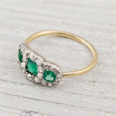 antique three and emerald engagement ring