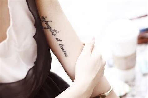 unbreakable tattoo in latin infragilis et tenera fragile and strong ink is art