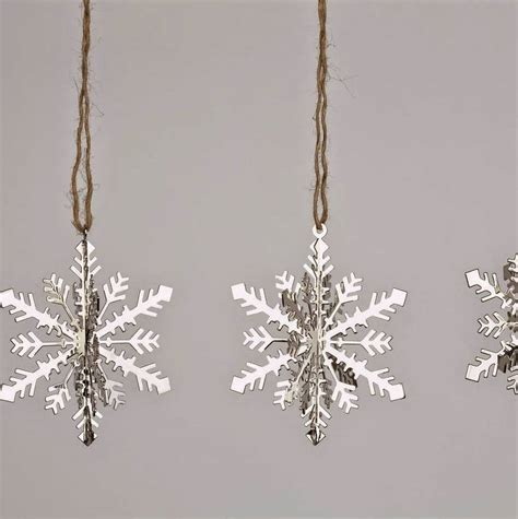set of four silver snowflake decorations by ella james