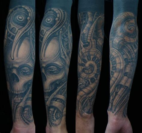 arm biomechanical skull tattoo by invisible nyc