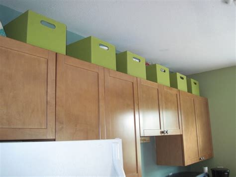 Storage Containers For Kitchen Cabinets by Use The Space Above Kitchen Cabinets For Extra Storage In