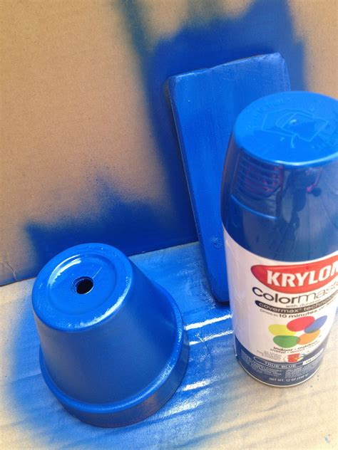 krylon spray paint up a blue flowerpot of patriotic