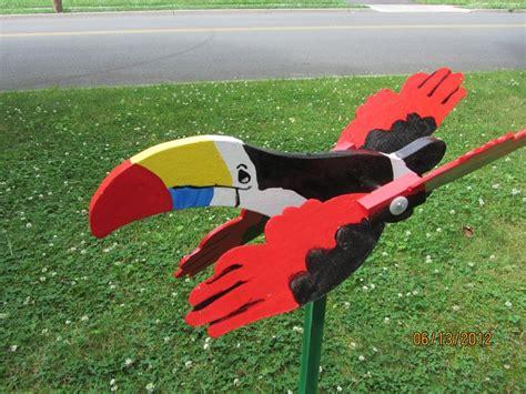 Handmade Whirligigs - handmade handpainted wooden tropical toucan whirligig