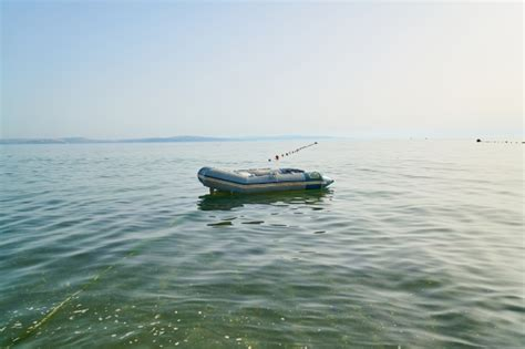 floating boat photo boat floating above sea water photo free download