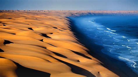 dunes   namib desert meet  atlantic ocean namibia