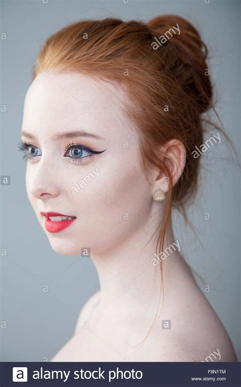 download hair tied up portrait of a pretty redheaded woman with her hair tied up
