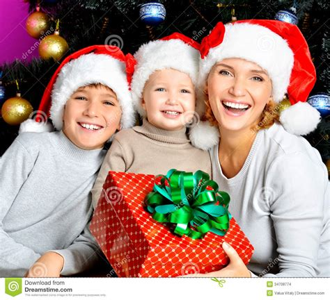 new year gift for child happy with children holds the new year gift stock