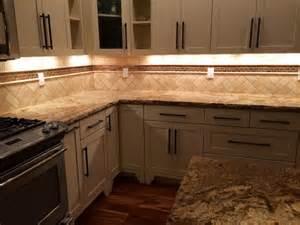 white kitchen cabinets herringbone travertine and copper