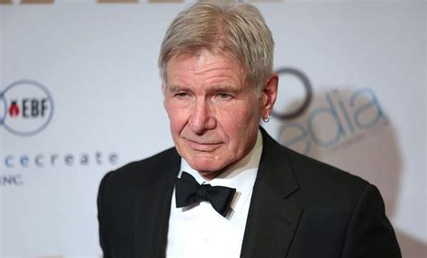 real life action hero harrison ford races to help car