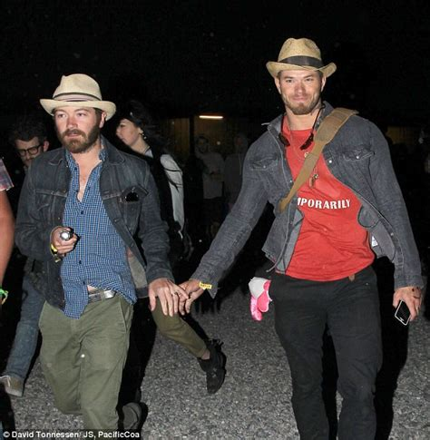 kellan lutz and danny masterson hold hands at coachella s