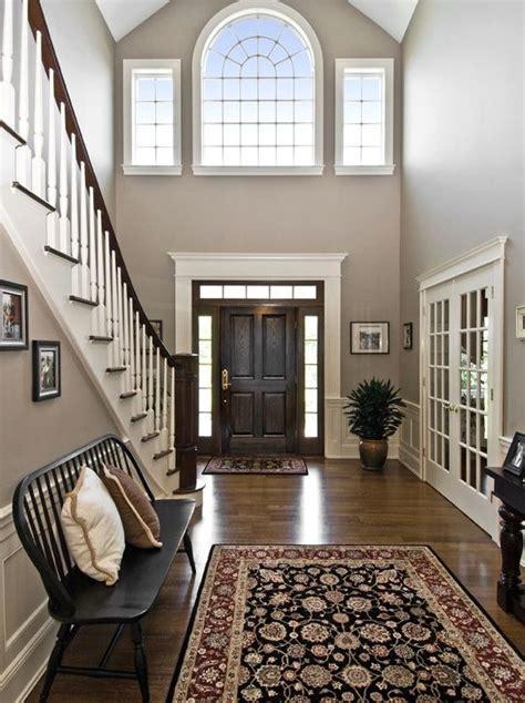traditional entryway  high ceiling hardwood floors