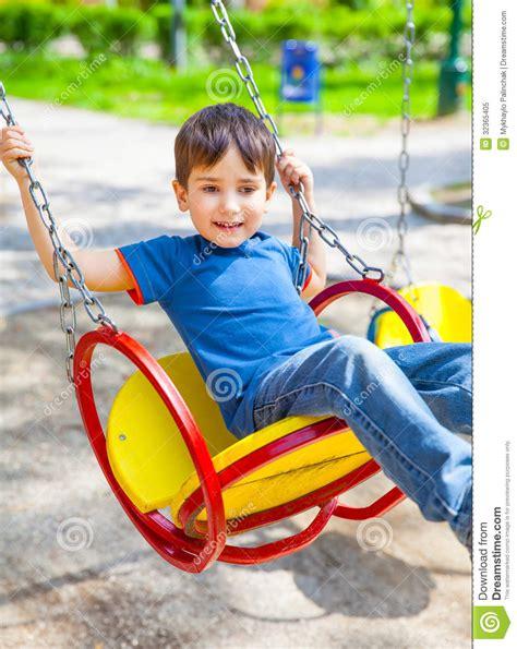 boy swing joyful little boy swinging on a swing royalty free stock