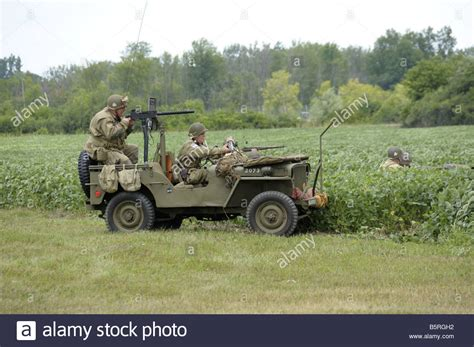 ww2 jeep with machine gun soldiers in a jeep with a machine gun mounted on it at a
