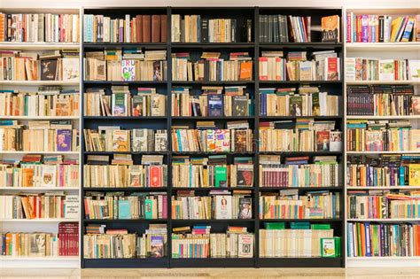 bookshelf with second books for sale editorial