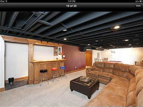 Paint basement ceiling infrastructure black to save money