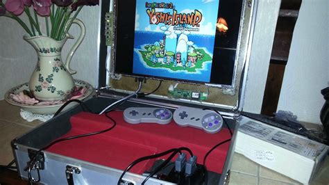 diy raspberry pi projects this raspberry pi powered diy gaming briefcase plays all