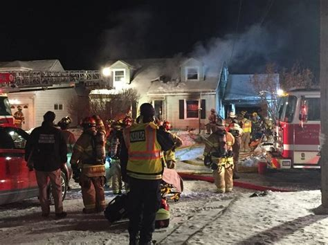 woman transported  hospital  house fire  north