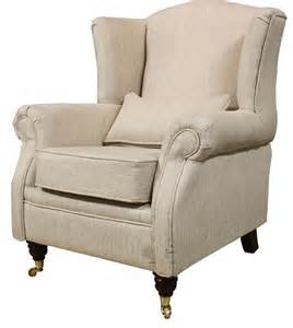 high wing back armchair wing chair fireside high back armchair zoe plain biscuit