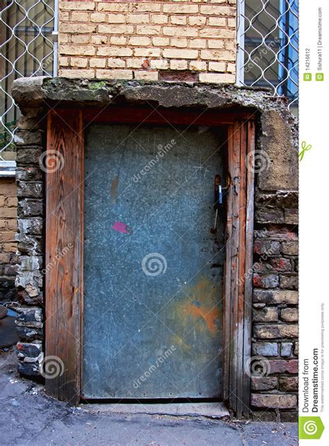 grey metal door of the basement stock photography image