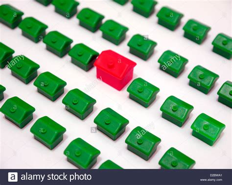 monopoly buying houses monopoly houses on a white background representing finding the stock photo royalty