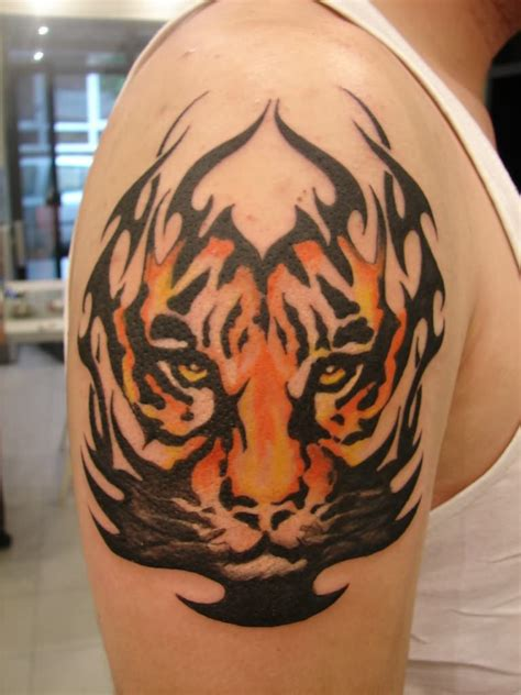 tribal tattoos on arm and shoulder tribal tiger on shoulder