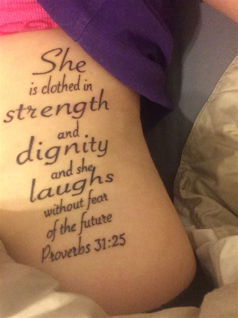 she is clothed in strength and dignity tattoo she is clothed in strength and dignity and she laughs