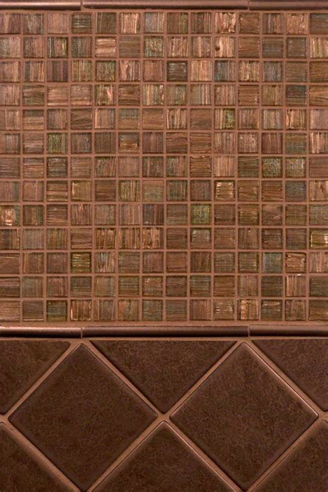 copper glass tile backsplash copper metal and light brown iridescent glass backsplash
