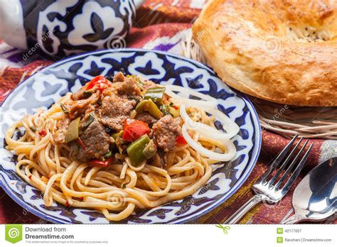 uzbek national cuisine main courses uzbek national food lagman on traditional fabric adras